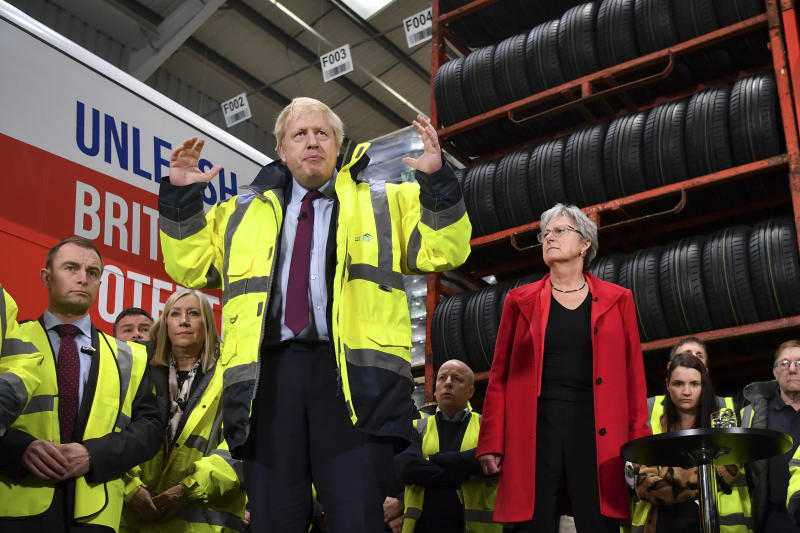Britain's Prime Minister Boris Johnson talks during a question and answer session, part of a General Election campaign visit to Ferguson's Transport in Washington, England, Monday, Dec. 9, 2019. Chair of the Vote Leave Gisela Stuart, stands at right. Britain goes to the polls on Dec. 12. (Ben Stansall/Pool Photo via AP)
