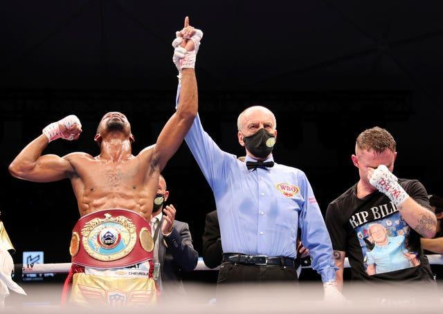 Herring has his arm raised in celebration after stopping Frampton in the sixth round