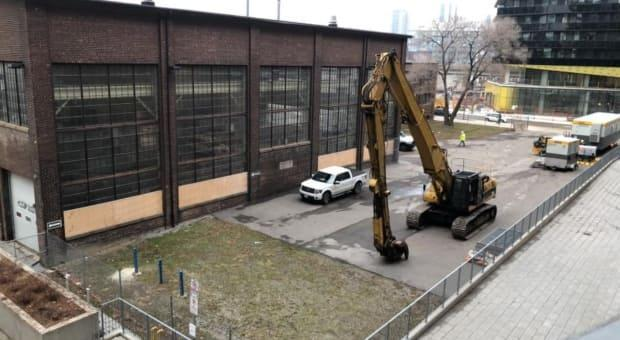 Community members have been fighting to stop the province from demolishing four industrial heritage buildings on the site. One building is already damaged by a demolition crew.