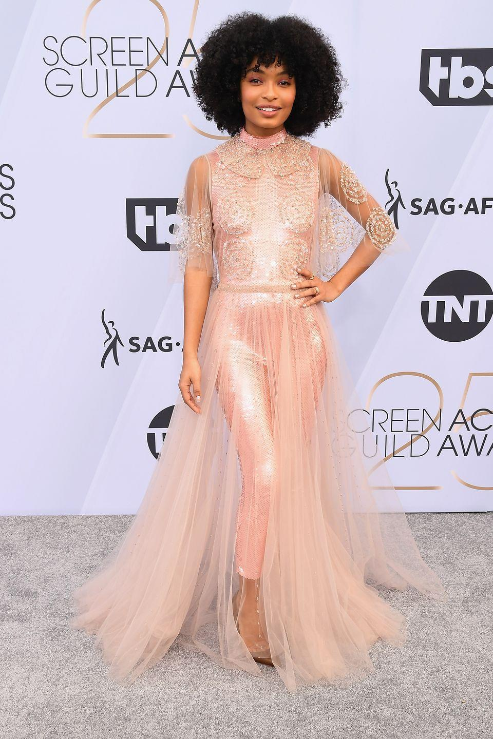 """<p>One of the easiest hairstyles for natural hair is a simple wash-and-go, like the one actress <strong>Yara Shahidi</strong> is sporting here. To achieve this look, wash and <a href=""""https://www.goodhousekeeping.com/beauty-products/g26212823/best-conditioner-for-dry-hair/"""" rel=""""nofollow noopener"""" target=""""_blank"""" data-ylk=""""slk:condition your hair"""" class=""""link rapid-noclick-resp"""">condition your hair</a> as usual and follow up with your favorite <a href=""""https://www.goodhousekeeping.com/beauty/hair/g28799272/best-hair-products/"""" rel=""""nofollow noopener"""" target=""""_blank"""" data-ylk=""""slk:styling products"""" class=""""link rapid-noclick-resp"""">styling products</a> for perfectly-defined spirals every single time. </p>"""