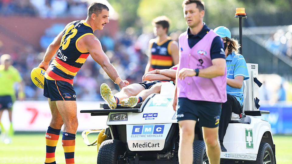 Seen here, Adelaide's Jake Kelly is taken from the ground after a sickening head clash.