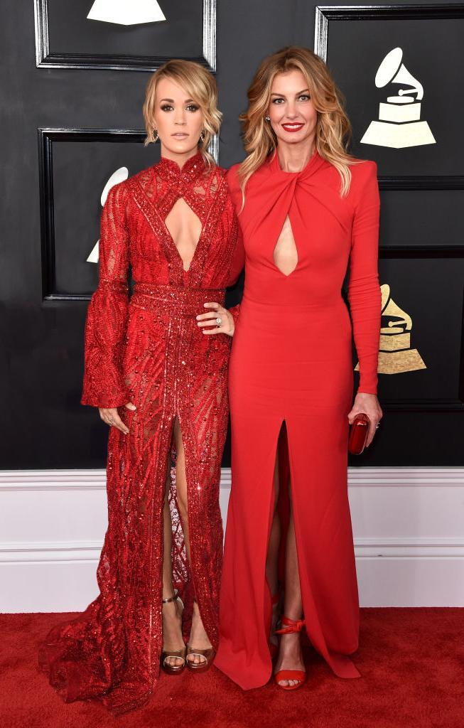 Country singers Carrie Underwood and Faith Hill matched in red at the 2017 Grammy Awards. (Photo: Getty Images)