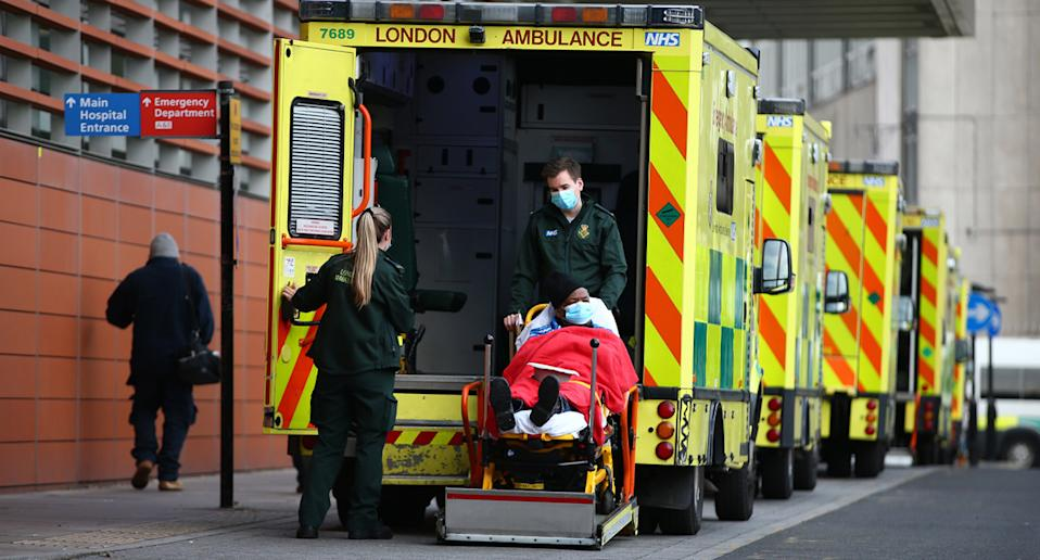 A patient outside The Royal London Hospital a day after London recorded 50,000 new cases in one day. Source: Getty Images