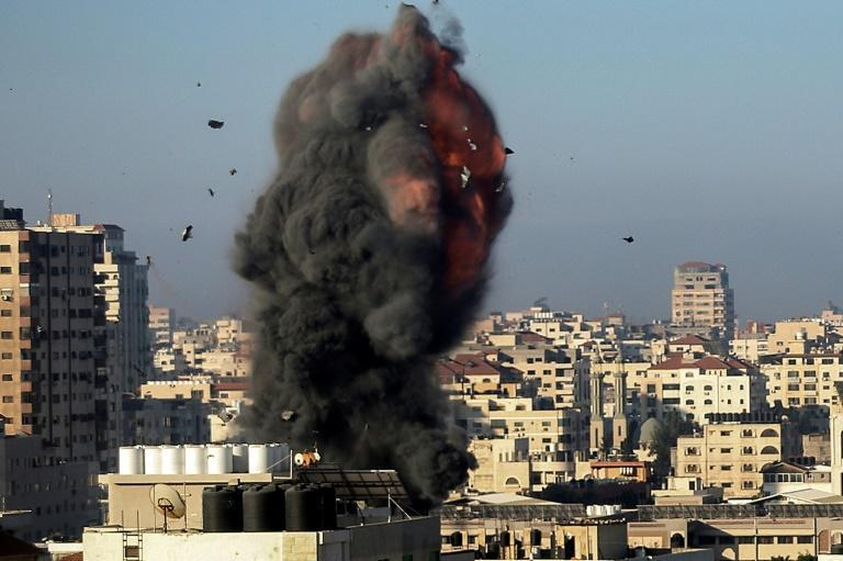 Smoke billows over the Hamas-linked Ansar compound in Gaza City, one of many symbols of the Islamist movement's authority in Gaza that Israel has targeted in its bombing campaign