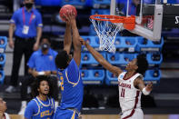 UCLA forward Cody Riley (2) dunks on Alabama guard Joshua Primo (11) in the second half of a Sweet 16 game in the NCAA men's college basketball tournament at Hinkle Fieldhouse in Indianapolis, Sunday, March 28, 2021. (AP Photo/Michael Conroy)