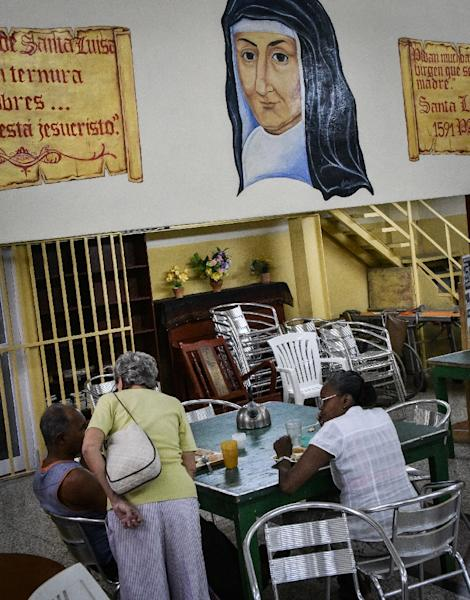 Cuban emigration has resulted in abandoned elderly people and government-run retirement homes tend to be overcrowded and poorly maintained (AFP Photo/Adalberto Roque)