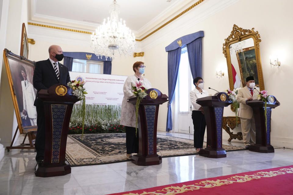 In this photo released by the Indonesian Ministry of Foreign Affairs, Australian Foreign Minister Marise Payne, second left, and Defense Minister Peter Dutton, left, attend a virtual press conference with their Indonesian counterpart Retno Marsudi, second right, and Prabowo Subianto, right, after their meeting in Jakarta, Indonesia, Thursday, Sept. 9, 2021. Australia's foreign and defense ministers are visiting Indonesia, India, South Korea and the United States to bolster economic and security relationships within the Asia-Pacific region, where tensions are rising with China. (Indonesian Ministry of Foreign Affairs via AP)