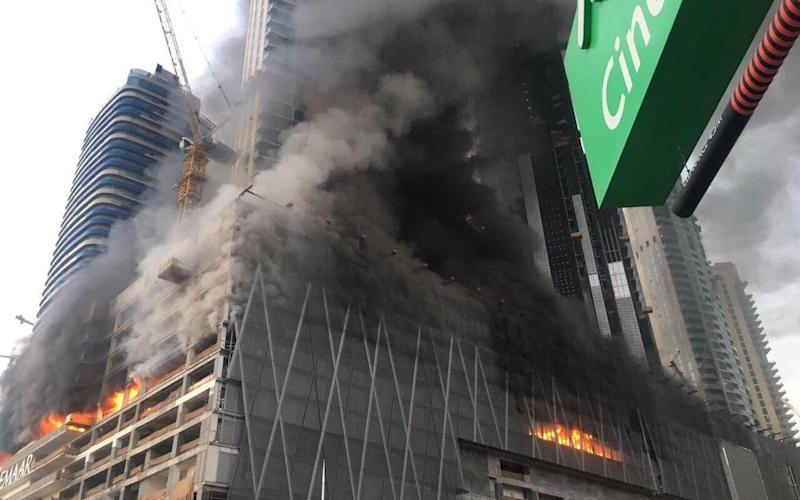 The blaze began on a parking level of the 72-story Fountain Views building - Credit: handout/Reuters