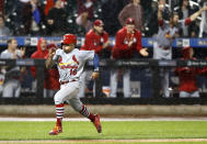 St. Louis Cardinals react from the dugout as Cardinals' Kolten Wong hustles home on Harrison Bader's double during the ninth inning of a baseball game against the New York Mets, Thursday, June 13, 2019, in New York. (AP Photo/Kathy Willens)