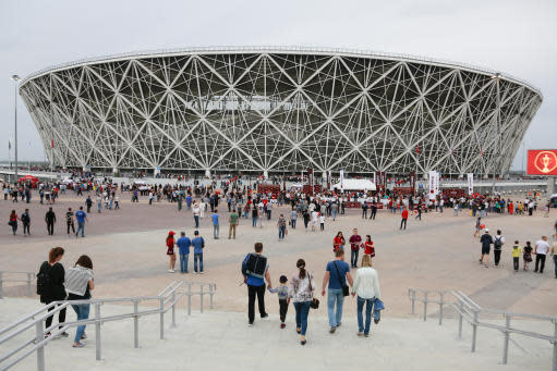 In this photo taken on Saturday, April 21, 2018, a view on the new the World Cup stadium during the Russian league soccer match between Rotor and Luch-Energiya in Volgograd, Russia. The stadium will hold group-stage games at the World Cup. Several of Russias 12 World Cup stadiums look set to be largely empty after the tournament. Its a problem for Russia, which is spending almost $11 billion on the World Cup, and for FIFA. Fans and officials predict more government money will be needed to maintain several stadiums set to host mostly unglamorous lower-league games. (AP Photo/Dmitriy Rogulin)