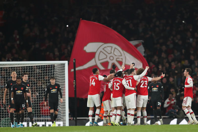 LONDON, ENGLAND - JANUARY 01: Sokratis Papastathopoulos of Arsenal celebrates with teammates after scoring a goal to make it 2-0 during the Premier League match between Arsenal FC and Manchester United at Emirates Stadium on January 1, 2020 in London, United Kingdom. (Photo by James Williamson - AMA/Getty Images)