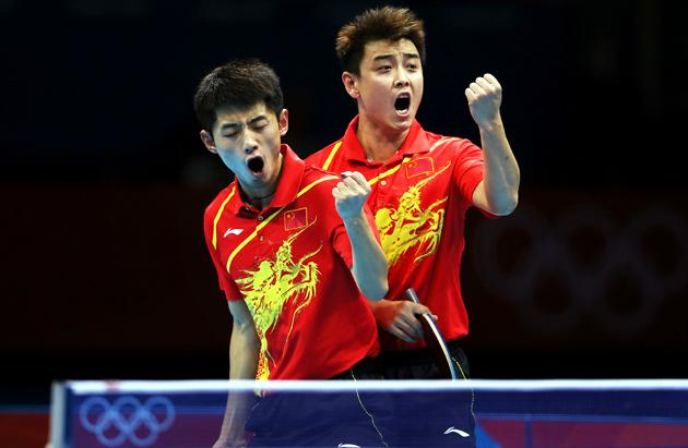 LONDON, ENGLAND - AUGUST 06:  Jike Zhang and Hao Wang of China celebrate victory against Timo Boll and Bastain Steger of Germany in the doubles match of the men's team competition during the 2012 London Olympics at the ExCeL North Arena on August 06, 2012 in London, England.  (Photo by Ian MacNicol/Getty Images)