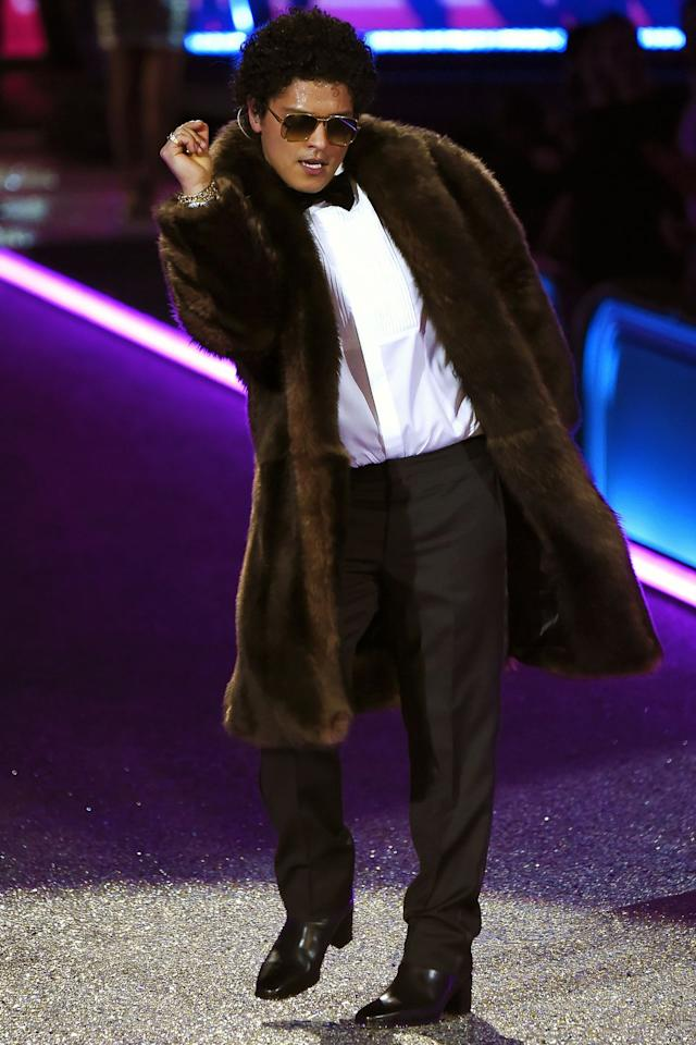 <p>Here is Bruno, casually wearing a tuxedo shirt under an long-hem fur. Very extra. Also, note the sunglasses inside - the continuation of an ongoing theme.</p>