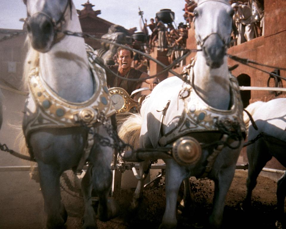 Charlton Heston (1923-2008), US actor, in costume and riding a horsedrawn chariot in a publicity still issued for the film, 'Ben-Hur', 1959. The historical drama, directed by William Wyler (1902-1981), starred Heston as 'Judah Ben-Hur'. (Photo by Silver Screen Collection/Getty Images)