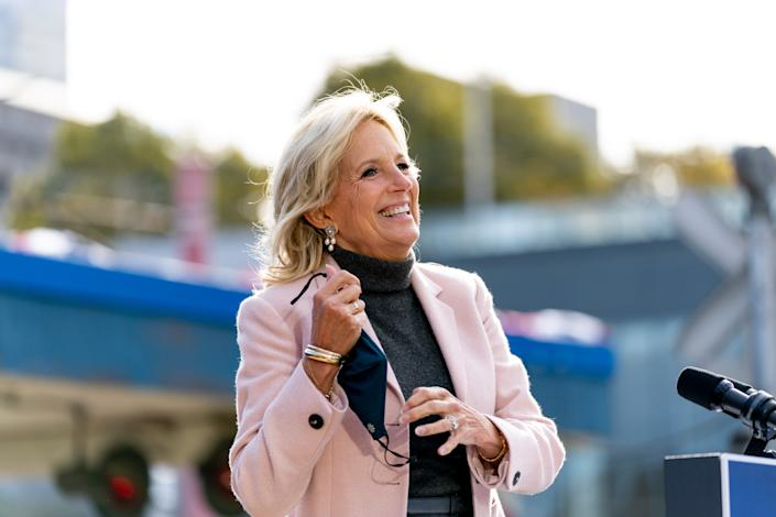 Jill Biden, the wife of Democratic presidential candidate former Vice President Joe Biden, takes off her mask to speak at Amtrak's Cleveland Lakefront train station, Wednesday, Sept. 30, 2020, in Cleveland, Biden is on a train tour through Ohio and Pennsylvania today.