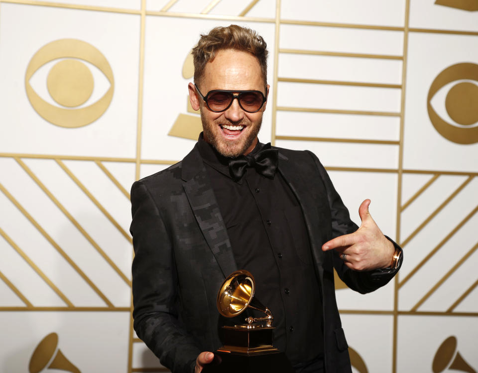 """Tobymac holds the award for Best Contemporary Christian Music Album for """"This Is Not A Test"""" during the 58th Grammy Awards in Los Angeles, California February 15, 2016.  REUTERS/Lucy Nicholson"""