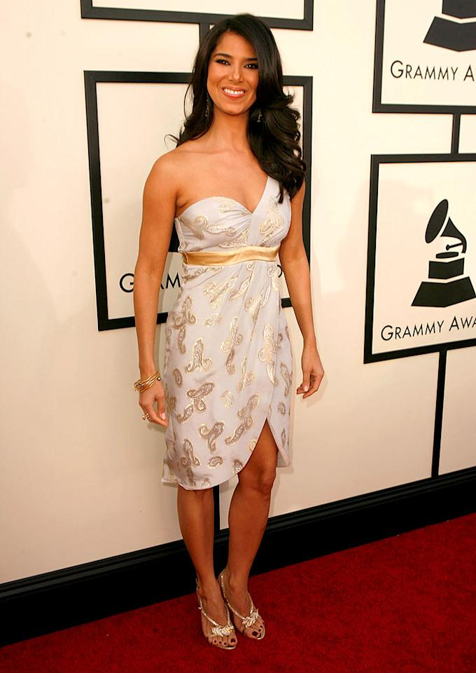"""Actress/musician Roselyn Sanchez paired a cheap-looking gold and white gown with strappy sandals and a beautiful smile. Jeff Vespa/<a href=""""http://www.wireimage.com"""" target=""""new"""">WireImage.com</a> - February 10, 2008"""