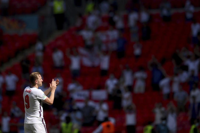 England's Harry Kane applauds fans as he celebrates his side's 1-0 win at the end of the Euro 2020 soccer championship group D match between England and Croatia, at Wembley stadium, London, Sunday, June 13, 2021. (Laurence Griffiths, Pool via AP)