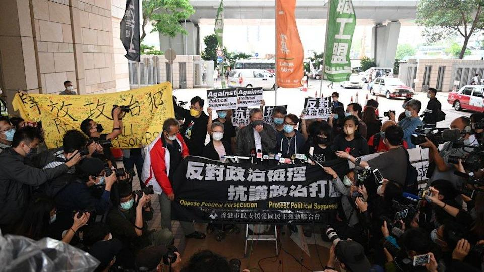 Pro-democracy activists including former lawmaker Lee Cheuk-yan (C) rally at the courthouse - 16 April
