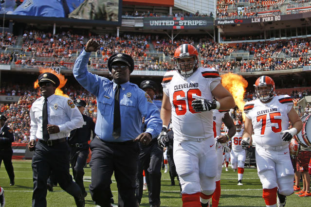 <p>The Cleveland Browns run onto the field with members of the military, police, fire and EMS before the game against the Pittsburgh Steelers at FirstEnergy Stadium on September 10, 2017 in Cleveland, Ohio. (Photo by Justin K. Aller/Getty Images) </p>