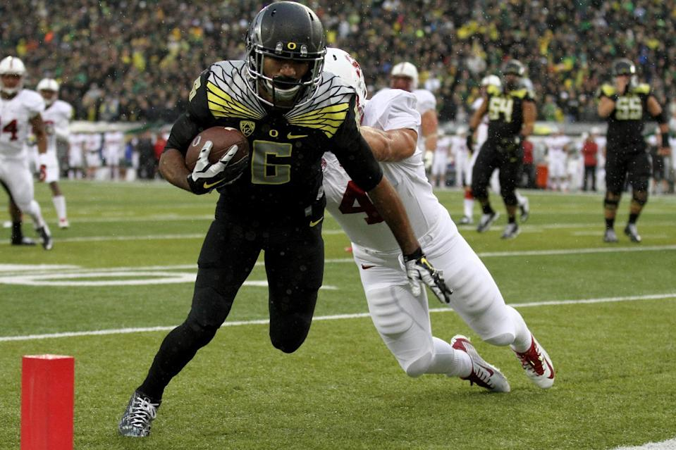 Oregon wide receiver Charles Nelson (6) is pushed into the end zone for a touchdown during the first quarter against Stanford in an NCAA college football game in Eugene, Ore., Saturday, Nov. 1, 2014. (AP Photo/Ryan Kang)