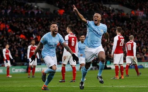 "There are more important matches to play and far more formidable ­opponents to face, but the Pep Guardiola era at Manchester City has achieved its first piece of silverware, and the significance of that should not be underestimated. The glittering prizes of the ­Premier League, for which they are champions-elect, and the Champions League, remain in their ­immediate sights, but they are ­cruelly distant dreams for an ­Arsenal side who are slipping away season by season under Arsene Wenger. Instead, football supporters in this country, and maybe even around Europe, are going to have to get used to the sight of players in those sky blue jerseys cavorting on the pitch in celebration. The quadruple may have gone, but the treble remains distinctly possible. This appears the first of many trophies for Guardiola's City and a glance at the substitutes' bench showed the youthful power they have to call on for the future. That bench had an average age of just 21.6 years, with 17-year-old Phil Foden coming on late in the game. ""Win titles and you have to win more,"" Guardiola said afterwards. It sounded like a promise; a mantra; a threat to the opposition. City did not even have to play that well to overwhelm Arsenal and win the Carabao Cup with goals by Sergio Aguero, Vincent Kompany and David Silva, and it felt ­appropriate – given the accusations of spending and buying success – that those goals came from three players who Guardiola inherited, three players towards the end of their careers who already have ­legendary status at the club. And so it was the old guard who ushered in the new era. Arsenal vs Manchester City player ratings But Guardiola has made those players even better, which used to be what marked out Wenger. Now the Arsenal manager appears ever more like King Canute as he tries to defy the inevitable, and even when he involved himself in a touchline spat with Guardiola, following City's first goal, he appeared like a man raging against the waves that were set to overwhelm him. When City did turn it on after half-time, Arsenal were left drowning. On that touchline, Guardiola wore a yellow ribbon in support of imprisoned Catalan politicians – in defiance of the Football Association charge against him – and defiantly said he would continue to do so. As for the result, he appeared both elated and relieved as he joined in the celebrations. Sergio Aguero lobs home the opener Credit: AP Having exited the FA Cup this week against League One Wigan Athletic, Guardiola could not ­countenance another cup defeat, but this was never in doubt. Afterwards, Guardiola even admitted that, in the first half, his team had felt the pressure of playing a final. Now that has gone. Arsenal were disorganised, dispirited, lacking in resilience and leadership and at their passionless worst with the much-vaunted ­renaissance of Jack Wilshere ­ending in the midfielder trying to get City players booked. The fact is, Arsenal do not even play good football any more. An unhappy day for Jack Wilshere Credit: AP The only setback for City was a hamstring injury to Fernandinho, which appears set to rule him out for several weeks, and the key ­midfielder is a player they may struggle to replace. The manner of the goals said it all, especially the first goal. For all the brilliant purity of City's football this season it was ironic that they scored from a route-one punt up the field from goalkeeper Claudio Bravo. It seemed simple enough to deal with, but the ball sailed over the head of the hapless Shkodran Mustafi, who stood appealing that he had been nudged by Aguero, who ran on to lift his shot over ­goalkeeper David Ospina and into the net. Vincent Kompany scores the second of Man City's three goals against Arsenal That was Arsenal's soft centre summed up. It was woeful defending from Mustafi, who had to be stronger, while Aguero claimed his 199th goal for City and his 30th in 34 appearances – the fourth campaign in the past seven he has reached that mark. The striker's contribution could be contrasted with the effort of Arsenal's record signing, Pierre-Emerick Aubameyang, who ambled around the pitch, and for such a quick striker was off the pace. Aubameyang could even have opened the scoring, but was slow to convert Mesut Ozil's pass, allowing Kyle Walker to challenge him and Bravo to smother the ball, and he was then somehow caught by Kompany in a race for the ball and was eased off it by the City captain. It was just not good enough. City mob their goalscoring captain Kompany Credit: REUTERS Contrast that, also, with the determination Kompany showed in claiming his goal and in the awful defending that led to it, as Arsenal needlessly conceded a corner and failed to mark Ilkay Gundogan on the edge of the area as Kevin De Bruyne cut it back to him. The first-time shot was diverted home by Kompany with an outstretched boot, ahead of Laurent Koscielny, and the sense of joy he showed was a release of all the frustration felt over his injury problems. It also meant it was game over. Already. Wenger complained that it should have been ruled out for ­offside – presumably his argument was that Leroy Sane was obstructing Ospina's view – but straws were being clutched once more. City hold aloft the League Cup trophy Credit: REUTERS Arsenal fans began to stream away, and that became an exodus as City claimed their third. Yet again, it was a result of appalling defending as Wilshere lost the ball for the umpteenth time and Danilo quickly slid a pass through to Silva, who was just too quick, too sharp, for the lumbering Calum Chambers. The wonderful midfielder fired a powerful low shot across Ospina and into the corner of the goal. ""Everything went against us,"" Wenger later lamented. It did not. Arsenal were simply, unarguably, not good enough. ""One down, more to go!"" De Bruyne later tweeted. It felt like a promise rather than a hope or boast. City under Guardiola have their lift-off. 6:57PM Here's Arsene ""In the game we had the first good chance, a very easy one that we missed. We made a big mistake after that for the first goal. We controlled them quite well in the first half. We made a poor start to the second half. We are unlucky as well because the second goal is offside. I wanted to make a change at 2-0 but the game didn't stop. Overall congratulations to Man City. ""When you lose games and make mistakes you have to accept criticism. It's emotional after a final so you do not want to get too much into criticism. We have to recover quickly. We came to the final, we lost, we now have to focus on the next Premier League game. ""When you lose 3-0 you of course have to look at defending better. I did feel that for periods in the game we defended well but we then lost concentration and against good teams you will be punished. ""It's not the application that's missing, it's just lapses in concentration in key moments. I do believe we were unlucky, I've just watched the second goal again, it was an important goal in this game and it was 100% offside. We didn't give too many chances away today but we gave easy chances away."" Schadenfreude. 6:51PM Winners are grinners Kyle Walker: ""It's been a long time coming, it's good to get my first one. I was nervous coming in today after missing out a couple of times here before. We needed to kill the game a bit, Sergio's goal was well taken and did that for us."" Kevin De Bruyne: ""Last time I missed it because of injury, it's nice to play and very happy that we won it. We deserved to win, and we now have to go onto Thursday. We have a good feeling all season but it's not finished yet, we know what we have to do in the league and in the Champions League."" 6:45PM Pep tells us ""We are so happy, big congratulations for all of Man City, the big bosses, and all of our fans. The first half was not good, a lot of mistakes in the simple passes. The second half we played with more courage and personality, in the second half we were outstanding. We now have to focus absolutely on the Premier League. It's for Manchester City, it's not for me."" One down... 6:33PM Kompany lifts the trophy Pep Guardiola has stayed downstairs and wants to leave the medal collection and cup lifting to his players, despite this being his first trophy in this country with City. Man of the Match and captain Vincent Kompany does the honours, the first part of what will certainly be a double and could turn out to be a treble. They get the headlines, the plaudits, the medals and the trophy, but there's a hell of an inquest to be held into exactly what Arsenal were up to this afternoon. First of many? Talk to me about that one lads. 6:31PM City climbing the steps City making their long way up to the royal box to collect the trophy. 6:26PM Man of the Match Kompany says... ""Before the game honestly I thought I was going to score. I came close a few times. It's a bit of luck on the day but also self belief as well. I've been 15 years in the game, I'm training well and supporting the lads when I don't play and I give everything when I do play. You get the call up and do the job."" Captain fantastic. 6:24PM Full time Man City 3 Arsenal 0 Pep Guardiola wins his first trophy in the UK at an absolute canter. The League Cup continues to elude Arsene Wenger after 22 years. As one-sided a cup final as you'll ever see, Arsenal simply didn't turn up. Aguero, Kompany and Silva with the goals. 6:20PM 90 mins Three minutes added. Seems unnecessarily cruel. Not ideal. 6:18PM 88 mins Aguero goes off to a standing ovation. Young Phil Foden comes on, 17 years old. 6:17PM 87 mins Otamendi gets across the near post and hammers a dangerous Arsenal cross behind for a corner. Solid. 6:15PM 84 mins Wilshere getting cranky (low blow to do a cigarette joke here?), pushing Jesus away requiring Craig Pawson to intervene with a yellow. More stewards than Arsenal fans inside Wembley now. Only ten more minutes Jack. 6:11PM 80 mins Good bit of keeping from Bravo, sliding under Iwobi and denying him a one on one chance. Fernandinho injured earlier, Walker now injured fouling Xhaka, not ideal with Premier League and Champions League commitments coming up. 6:07PM 76 mins Jesus returns These sides meet again in the league on Thursday of course, but any thought of City taking the foot off the gas allayed by the introduction of Gabriel Jesus from the bench. Just what Arsenal need. Neville is just a permanent background noise at the moment, 17 minutes into a fuming monologue and showing no signs of coming up for air. ""These Arsenal players have had far too many chances over far too many years. They've proved to everybody else they're not good enough. Arsene Wenger's faith in them has been far too great."" Jesus rises again. 6:05PM 75 mins Arsenal have had a shot Hold that front page. Xhaka shoots over from 30 yards out. 6:02PM 72 mins Ramsey off for Iwobi Started the game well but this is something of a mercy killing from Arsene Wenger. Ramsey, ""one of the walkers"", trudges off and Alex Iwobi comes on. 5:57PM 65 mins Danny Welbeck comes on for Arsenal, Neville has gone rogue. ""They're an absolute disgrace. Walking on the football pitch at Wembley. Ramsey, Xhaka, they've given up. They're a disgrace. Spineless. At least City are playing properly."" Any score you like. 5:55PM GOOOOOAAAALLLLLL!!!! MAN CITY 3 Arsenal 0 (David Silva 64 mins) Where Arsenal go, is 3-0 down. Jack Wilshere tries to pull a ball out of the air on the corner of the penalty box and loses it. City work Silva into the left channel of the penalty box and he finishes low across Ospina into the far corner for 3-0. Arsenal 0 - 3 Man City (David Silva, 65 min) 5:52PM 62 mins Low City cross from the right nearly has Sane in for a third at the near post. Arsenal briefly break three v two but Ozil plays a poor pass and the move breaks down. The quality of this final has been in association with the tournament's sponsors. A fitting finale to a trainwreck of a competition.— Nick Friend (@NickFriend1) February 25, 2018 5:51PM 61 mins Well, I don't really know where Arsenal go from here. Poor in the first half, they've barely taken part in the second. Not at the races, and City haven't even played that well. Gary Neville: ""Look at Ramsey he's walking, Xhaka is walking, Ozil is walking. Don't walk. Don't walk at Wembley. Run. Look at Ramsey and Xhaka, look at them walking back, central midfield players."" Thoroughly deserved. Vincent Kompany comfortably the best player on the pitch today. He's been everywhere.— Ben Rumsby (@ben_rumsby) February 25, 2018 5:48PM GOOOOOOOAAAAAAAALLLLLLLL!!! MAN CITY 2 Arsenal 0 (Vincent Kompany 57 mins) It's Kompany that wins the corner in the first place with a surprisingly turn of pace and skill wide left. City play the set piece to the edge of the area where Gundogan hits a low shot through a crowded area - Kompany, on his return to the side, diverts the ball in from close range. Arsenal 0 - 2 Man City (Vincent Kompany, 58 min) 5:45PM 53 mins Bravo gone walkabout This battle of the reserve team goalkeepers has taken another twist. Ball over the top from Arsenal looking to set Aubameyang away doesn't seem to pose too much danger with Kyle Walker in attendance, but Bravo comes tearing out 45 yards to clear and then misses the ball entirely. City escape. At the other end, Arsenal play a series of increasingly risky and elaborate passes in their own six yard box eventually forcing Ospina into a half volleyed clearance under his own cross bar. Madness. Coming through. 5:40PM 49 mins Fernandinho has picked up a knock, looks like a hamstring, suspect his race might be run. Still an odd game this, neither team really playing as they can, City marginally better while playing at about 65%. The other Silva is coming on for City. Look at Ospina taking his goal kicks short, like an idiot. You don't set up goals doing that.— Huw Davies (@thehuwdavies) February 25, 2018 5:37PM 47 mins Chambers carded As much as things change, they stay the same. City going down the left, attacking Arsenal first with Sane and then Aguero who draws a foul and a yellow card from Chambers. Free kick whipped across, headed out for a corner. Right the way through the area, returned with interest, half volley from Kompany deflects and bobbles just wide of the post. 5:34PM 46 mins We are back underway. No subs. Reminded that Monreal was replaced by Kolasinac early in the first half. City lead 1-0, neither side really playing well. 5:30PM Second half Mustafi's defending being compared to Under 9s football in the half time analysis - an insult to a lot of the Under 9s football I've watched in my time. Anyway, let's see if there's a bit more quality for us in the second half. >If you concede a goal direct from a goal kick the entire defence should be fined two weeks wages !!— Rodney Marsh (@RodneyMarsh10) February 25, 2018 5:21PM Half Time Man City 1 Arsenal 0 Not one anybody will be telling the grandkids about, unless the grandkids have been particularly naughty. A game summed up by its only goal - Bravo punts down the middle of the field, Mustafi produces a piece of defending that would disgrace a pub player, Aguero lobs out-of-position Ospina for 1-0. City have been the better side but far from fluent. Arsenal have spent the half wasting a succession of set pieces around the edge of the box. Arsenal vs Man City shots on goal Arsenal vs Man City shots on goal Arsenal vs Man City 5:18PM 45 mins We'll have two more minutes. 5:14PM 41 mins Arsenal want Fernandinho sent off for a late challenge on Wilshere moments after his yellow card. Craig Pawson plays advantage and doesn't return to the incident, and he's right - Wilshere was looking for it. Tightrope for the second half though. But mum! 5:11PM 39 mins For one moment there I thought we'd seen some genuine brilliance from Aguero as he almost manages to chip Ospina again from an impossible angle. De Bruyne follows up in the panic but can only find the side netting. 5:09PM 37 mins Odd pattern of the game continuing, with City conceding a succession of free kicks around their own penalty area. Arsenal have wasted half a dozen of them in the opening half hour, and Xhaka's nothing chip to nowhere isn't changing that. 5:07PM 36 mins Fernandinho booked A flurry of yellow cards, Fernandinho the latest for catching Wilshere late. Ozil stands over the free kick on the left corner of the penalty box... Too high for Mustafi. Poor. Fernandinho cautioned. 5:07PM 35 mins Vincent Kompany rolling back the years there, chasing Aubameyang into the City area and then, just as the Arsenal man looks like he's away, through on goal and ready to shoot, he puts a big shoulder in, sends him flying and brings the ball away. 5:06PM 34 mins City free kick wide on the right, to be whipped across by David Silva. Aguero heads over at the near post. 5:03PM 31 mins Ramsey booked Aaron Ramsey almost takes David Silva's face off with a boot so high it's just frightened air traffic controllers at Heathrow. Yellow. Bad lad. 5:02PM 30 mins Sight of goal for Wilshere after good approach work from Aubameyang, City clear the ball behind and get a goal kick when it should be a corner. VAR man had popped out to put the kettle on. 5:01PM 29 mins City pressing for a second Apart from Bravo launching it down the field, City's biggest threat so far is Sane running at Bellerin, who is on a booking already. On this occasion the City man drives into the area from wide left and forces a corner with a fierce shot. From the set piece, played short, Vincent Kompany heads over. 4:57PM 25 mins Monreal off Monreal is going off injured, possibly sustained during that earlier dive in the penalty area, and Kolasinac comes on to replace him. Does it hurt when I do this? 4:55PM 23 mins Bellerin booked Arsenal again caught out by one long ball down the field from Bravo. This time Bellerin wrestles De Bruyne to the floor and gets his fifth booking of the season. Of all the things Arsenal must have planned for with City this week, old Wimbledon-style punts off the keeper seemingly, and understandably, pretty low on the list. 4:54PM 22 mins Wilshere wins a free kick from City 25 yards out from goal, left of centre. Aarom Ramsey, who's started pretty well, steps up... low under the wall, Bravo watches it all the way and saves comfortably. 4:51PM 19 mins Guardiola and Wenger are involved in a heated incident on the touchline. If Arsenal genuinely think that was a foul on Mustafi by Aguero they're kidding themselves. I for one would like to hear from Roy Keane. Or Graeme Souness. Or both. Easy as that. 4:50PM GOOOOOOAAAAAALLLLLL!!!!! MAN CITY 1 Arsenal 0 (Sergio Aguero 18 mins) City take the lead. A rare long ball off Bravo catches Mustafi out, dropping in behind the centre back and allowing Aguero to run straight through the middle of Arsenal and chip Ospina who's miles off his line. Mustafi wants a foul, but it never is, lousy defending. Aguero has scored in his last five games against Arsenal and has 199 goals for City. Arsenal 0 - 1 Man City (Sergio Agüero, 18 min) 4:49PM 17 mins And that, as much as anything else, led to my drinking problem. 4:44PM 12 mins Arsenal penalty appeal Referee Craig Pawson shows no interest in theatrical fall in the penalty box by Monreal. Looked a dive.... Is a dive, lucky not to be booked. 4:43PM 11 mins Caption comp Not sure what's going on here. 4:40PM 7 mins Huge Aubameyang chance Arsenal's first attack should bring the opening goal. Wilshere rampaging through the heart of the City team sets up Ramsey who squares it through the goal mouth for Aubameyang to seemingly tap in the opener from close range. Bravo produces two outstanding saves at point blank range to keep him out. Possibly just offside on second glance so might have been scrubbed off on the review had it gone in. Bravo! 4:38PM 6 mins Aguero tricking, tripping and skipping into the area before seeing a shot blocked at close range. City, stung by what happened on Monday, really look in the mood. Kevin De Bruyne has just pulled a ball out of the sky with a first touch they'll write sonnets about in a thousand year's time. 4:37PM 4 mins Monreal and Kyle Walker have an almighty collision in front of the technical area and City have a free kick but, as we've come to expect, the knock it short and quick and we're back into a pattern of them dominating possession with Arsenal trying to hold a firm back five in front of them. 4:33PM 1 min Straight away, Sane getting at Arsenal down the City left, wins the game's first corner for his side. Silva's delivery is too deep for everybody but City return the ball to the danger zone and sane sees a volley blocked behind for another corner. First shot in anger. 4:32PM Kick off Arsenal kick off going from left to right as we're looking. You'll all be absolutely delighted to hear that VAR is in play today I'm sure. Let's see if we can get this finished before last orders eh? 4:28PM Ready to go Immaculate rendition of the anthem. Next it's Ray Winstone shouting at you to ""bet, bet, bet nagggggghhhhhh (when the fun stops, stop)"" and then we can kick off. 4:24PM Teams in the tunnel Here come the teams, anthems and handshakes away from kick off. Plastic flags a-go-go. 4:16PM Pre-match chat Here's Arsene Wenger and Pep Guardiola going completely off script with highly controversial pre-match interviews... Wenger: ""You're always nervous, it's a big fight to get there and on the day you want to turn up with a strong performance. We're playing a strong opponent, we want to be at our best and be efficient."" Pep: ""Unfortunately we still have some injured and suspended players but it's a final, it's not about the guys who are not available. It's important to be in the final, we want to win it, and after that we have the Premier League in our mind and trying to reach the final of the Champions League."" 4:12PM Yellow ribbon-gate Here comes Pep, ribbon seemingly in place. Pleased to see we're focused on the important stuff wrong with this great game of ours. �� @Dsquared2pic.twitter.com/QIgDRFXqh7— Manchester City (@ManCity) February 25, 2018 4:08PM Showpiece final for troubled competition A meeting between two of the so-called 'big five' in the Premier League is the final the competition organisers, and Far Eastern sponsors, would have wanted. But such a showpiece event is hardly with the Football League and Carabao deserve. Already a distant last priority for even most Championship teams, treated as a reserve competition by many until the very latter stages, the League Cup has been squeezed by the power of the premier League, Champions League and fixture congestion for several years. The last thing it needs is to be consistently undermined by its own organiser and backer, but that is what's happened on several occasions this season. The first round draw, at the behest of the fizzy drink manufacturer, was held in Bangkok, shown live on a Facebook feed with no sound, and featured Charlton Athletic and Forest Green being drawn twice, Oxford not getting a game at all and Wimbledon pulling Swindon despite them both being unseeded. With that nicely ironed out, we moved on to round two. Which was also seeded, presumably at the say so of some wrong 'un who looked at Premier League teams not taking the competition seriously and decided the answer was to give them an easier passage to the latter rounds. Somebody who looked at the dusty old cup draws with Sir Bert Millichip and Graham Kelly calmly pulling numbers out of a velvet bag and thought ""this needs sexing up a bit"". Say what you like about two crusty old suits and a sack of balls but Charlton Athletic only ever got one game when it was done like that, and they knew whether it was home and away. Which is more than many teams in round two did. The seeding apparently necessitated a third bowl of coloured balls - presumably because they like colours in Singapore or something - to decide whether the team drawn first would be home or away. I mean, call me old fashioned, but I didn't really see a problem with the old classic idea of the team coming out first being at home, but then I'm the sort of person who thinks Love Island is a bit rubbish so I don't think I'm ""target demographic"" for Plymouth v Notts County in the early rounds of the League Cup any more. QPR v Brentford, Watford v Bristol City, Palace v Ipswich and Norwich v Charlton were all originally announced as the other way around by John Salako who misunderstood what the red ball with HOME written on it meant. West Ham were drawn at home, but played away anyway, because as part of ""the most successful stadium migration in history"" (c Karen Brady) they couldn't play at home in August. Furthermore, Burton and Wolverhampton were in the unseeded half of the southern draw while Newport County were in the unseeded half of the northern draw – nice local derby with Leeds for the team from South Wales. Aston Villa also ended up in the north half, despite being further south than Wolverhampton and Burton. The organisers apparently struggling to even make head or tail of the Reader's Digest Book of the Road. One would think, after all that, having completely devalued the competition, having made yourselves an absolute laughing stock, having done enormous damage to the brand of the title sponsor in the eyes of the public they're presumably targeting with their liquified sugar, that you'd keep the third round draw on the straight and narrow. No seeding, no third pot, no John Salarko, no farce – just nice and simple home and away and let's try and salvage some sort of worth and respect from this plane wreck. Nah. They held the third round draw in Beijing. At four in the morning UK time. The league said this was to ""give the competition maximum exposure in the UK (!!), China and the South East Asian market"" which is ""not only an important factor for the EFL, but also our sponsors Carabao"" but went onto admit ""the draw itself will not be televised in the UK, or anywhere else."" And so this nonsense continued. The quarter final draw was supposed to be broadcast live on Twitter, but was delayed for more than an hour and then suddenly just issued as a press release with who'd drawn who. The Football League certainly aren't adverse to completely wrecking one of their own competitions - see the absolute state of what remains of the Football League Trophy - but it's been a real shame to see a historic comp like the League Cup treated the way it has been this season and we can only hope that a great game this afternoon between two of the best teams in the country goes someway to redeeming it. Stage is set. 3:52PM Guardiola on guard City manager Pep Guardiola, meanwhile, is trying to guard against nerves in his side ahead of this first final of the season. ""In the first finals you are more nervous than the next one. I try to say to the players to play more like a friendly game to be more calm, but also with more courage. ""I think it's a game we have to try to enjoy the most, it's a final. We are here to play these types of game, why to be nervous? Why to worry about win, win, win. ""It's just a game. But no regrets after the game. It's too late for 'I didn't do what I should do' because it's a final."" Yellow ribbon-gate escalating. 3:45PM Arsenal's leading man #YoPierre#AFCvMCFCpic.twitter.com/k0Xnv8m7HE— Arsenal FC (@Arsenal) February 25, 2018 3:41PM Wenger looking to make history Although he hasn't won the Legaue Cup before, and the debate about how long he can/should carry on as manager will continue to coin it in for ArsenalFanTV for many a long month to come, Arsene Wenger does have a very good Wembley record. The recent defeat to Spurs here, in what is of course technically a Tottenham home match, broke a run of nine straight wins at the national stadium for the Arsenal manager. Wenger has won on each of his last nine trips to Wembley when it's been a neutral venue and since April 2014 has won three FA Cup semi-finals, three FA Cup finals and three Community Shields. Wenger hunts first League Cup. 3:36PM Arsenal line up The Gunners look like this... Arsenal: Ospina; Bellerin, Mustafi, Koscielny, Chambers, Monreal; Xhaka, Wilshere, Ramsey, Ozil; Aubameyang Subs: Cech, Kolasinac, Mertesacker, Elneny, Maitland-Niles, Iwobi, Welbeck Stage is set. 3:31PM City team The Man City team for today's battle of the reserve goalkeepers looks like this... City: Bravo, Walker, Kompany (c), Otamendi, Danilo, Fernandinho, Silva, Gundogan, De Bruyne, Sane, Aguero Subs: Ederson, Stones, Laporte, Bernardo, Zinchenko, Foden, Jesus 3:05PM Hello, good afternoon, and welcome... It's a sure sign that spring is sprung when we're bracing ourselves for three feet of snow and preparing to hand out the first major domestic trophy of the season. Man City, denied a historical quadrupal by, of all things, Wigan Athletic on Monday can put that behind them and take the first step towards a mere treble if they pick up the League Cup this afternoon. Their opponents Arsenal are hoping, for the third season in a row, to cover up a disappointing league season with some silverware - FA Cup winners for the last two seasons but Arsene Wenger has never won this trophy in all his 22 years in charge. Kick off at half four, we'll have team news for you just as soon as it arrives."