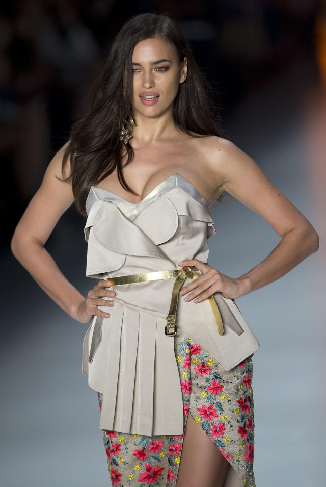 Russia's model Irina Shayk wears a creation from the Triton Summer collection during Sao Paulo Fashion Week in Sao Paulo, Brazil, Tuesday, April 1, 2014. (AP Photo/Andre Penner)