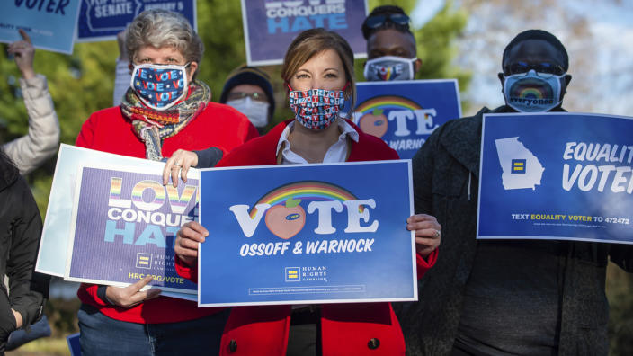 Human Rights Campaign Atlanta Governor Jen Slipakoff (center) poses for a photo with HRC supporters on Saturday Dec.19, 2020 during a get-out-the-vote event at a private residence in Dunwoody, Ga. (Bita Honarvar/AP Images for The Human Rights Campaign)