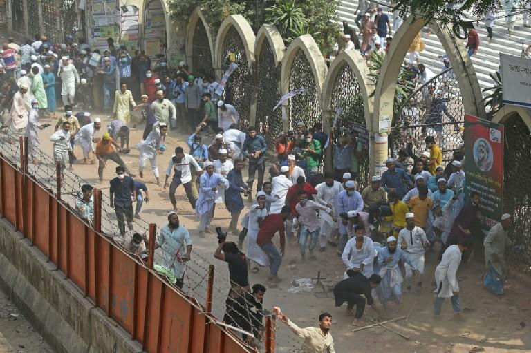 Activists from Islamist groups clash with police as they protest against the visit of Indian Prime Minister Narendra Modi in Dhaka
