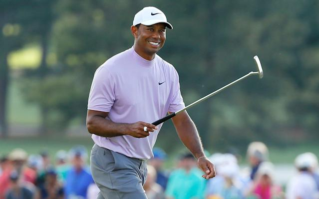 Woods is smiling and back in the hunt for a 15th major win - Getty Images North America