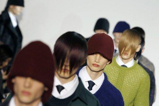 Models present creations by Belgian designer Raf Simons during the presentation of his Autumn-Winter 2012/2013 ready-to-wear Men's fashion collection in January 2012 in Paris. The Flemish Belgian works and lives in Antwerp, and his name had been repeatedly mentioned over recent months as a possible replacement for Galliano