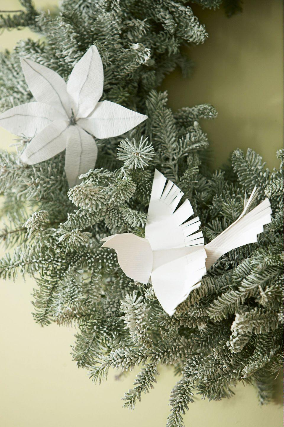 "<p>Evoke the peace and beauty of the season by whipping up some origami white doves. Tuck them in your tree or wreath, or hang above the holiday table.</p><p><em><a href=""https://www.goodhousekeeping.com/holidays/christmas-ideas/g393/homemade-christmas-ornaments/"" rel=""nofollow noopener"" target=""_blank"" data-ylk=""slk:See the idea »"" class=""link rapid-noclick-resp"">See the idea »</a></em><br></p>"