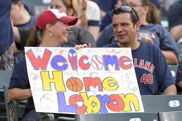 Cleveland Indians fans show their support for LeBron James during the game between the Cleveland Indians and the Chicago White Sox at Progressive Field on July 11, 2014 in Cleveland, Ohio (AFP Photo/Jason Miller)