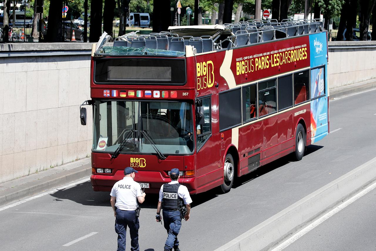 A double decker tour bus is removed by French police after an accident in a tunnel underpass injured tourists in Paris, France, June 23, 2017.    REUTERS/Jean-Paul Pelissier