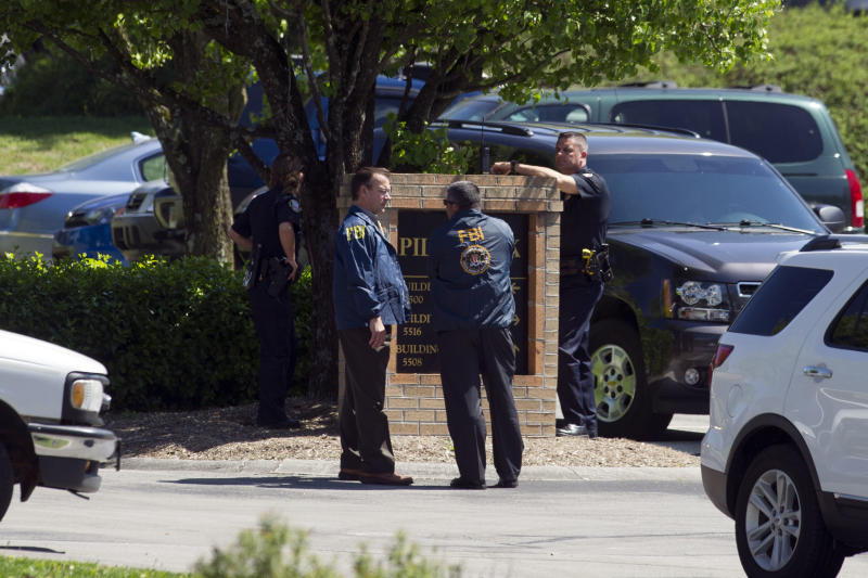 Federal agents raid the Pilot Flying J headquarters Monday, April 15, 2013, in Knoxville, Tenn. FBI and Internal Revenue Service agents on Monday locked down the Knoxville headquarters of Pilot Flying J, the truck stop business owned by the family of Tennessee Gov. Bill Haslam and his brother, Cleveland Browns owner Jimmy Haslam. (AP Photo/Knoxville News Sentinel, Saul Young)