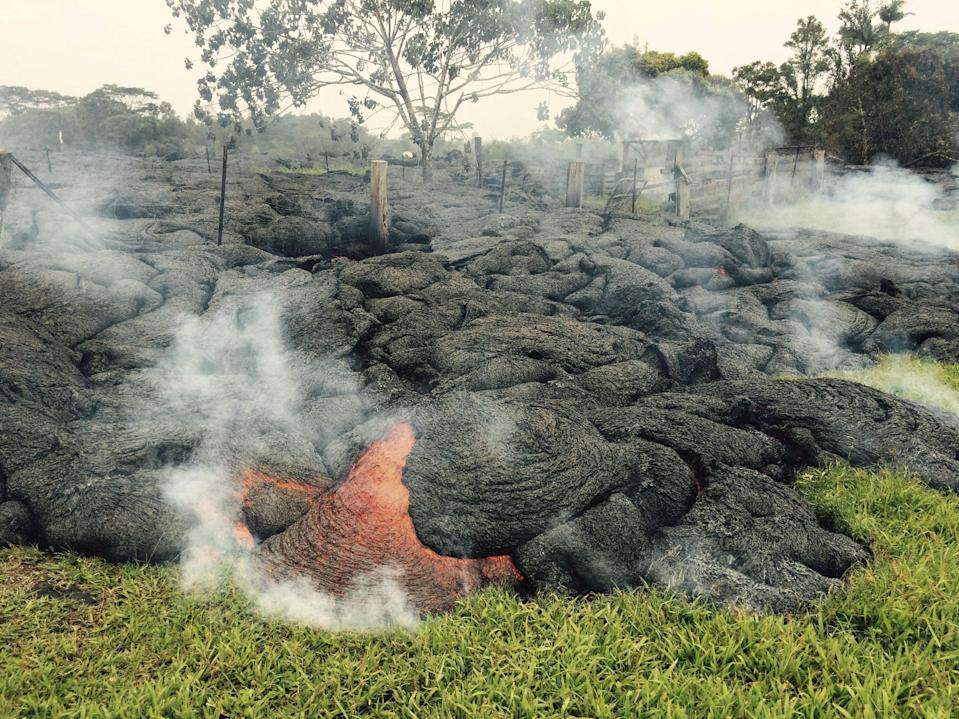 Molten lava from Hawaii volcano crosses onto residential property