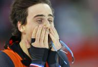 Second-placed Jan Smeekens of the Netherlands reacts after the men's 500 metres speed skating race at the Adler Arena during the 2014 Sochi Winter Olympics February 10, 2014. REUTERS/Laszlo Balogh (RUSSIA - Tags: OLYMPICS SPORT SPEED SKATING TPX IMAGES OF THE DAY)