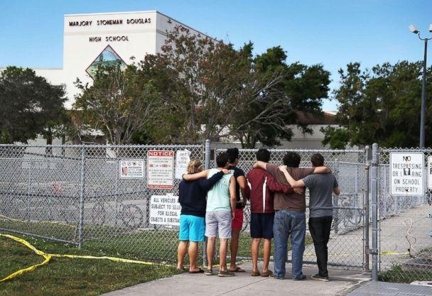 PHOTO: People look on at the Marjory Stoneman Douglas High School on Feb. 18, 2018, in Parkland, Fla. (Joe Raedle/Getty Images)