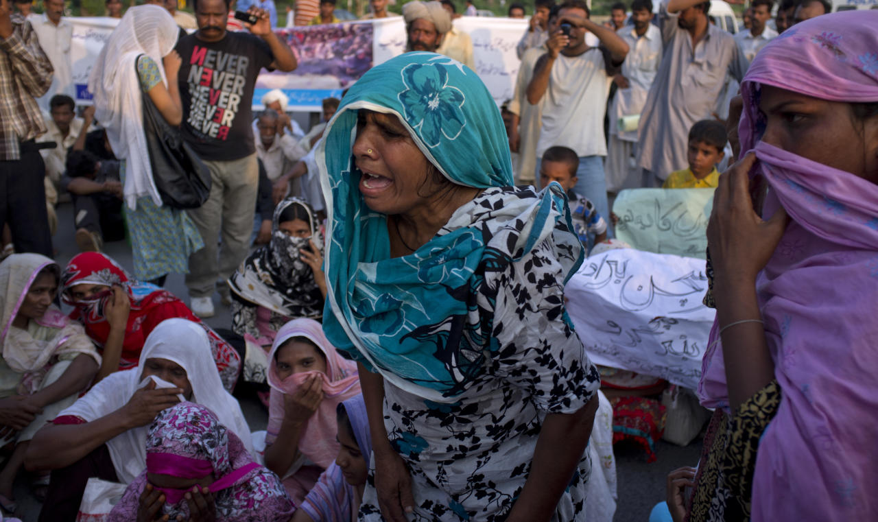 Pakistani Christians, who claimed to have been evicted from the neighborhood of a Christian girl arrested on alleged blasphemy charges, rally in Islamabad, Pakistan on Friday, Aug. 31, 2012. A Pakistani court Friday ordered a Christian girl accused of blasphemy to be held in prison for two more weeks as police finish their investigation and decide whether to charge her, her lawyer and police said. (AP Photo/B.K. Bangash)