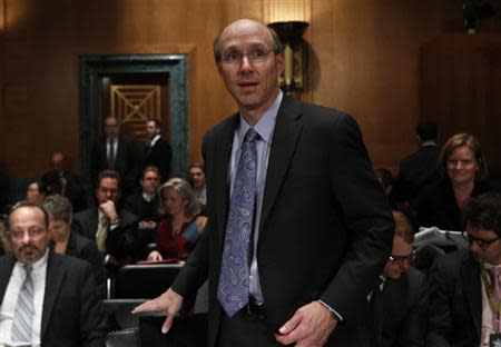 Federal Reserve's Division of Banking and Supervision and Regulation Director Gibson arrives to testify on physical commodities before the Senate Banking subcommittee on financial institutions and consumer protection on Capitol Hill in Washington