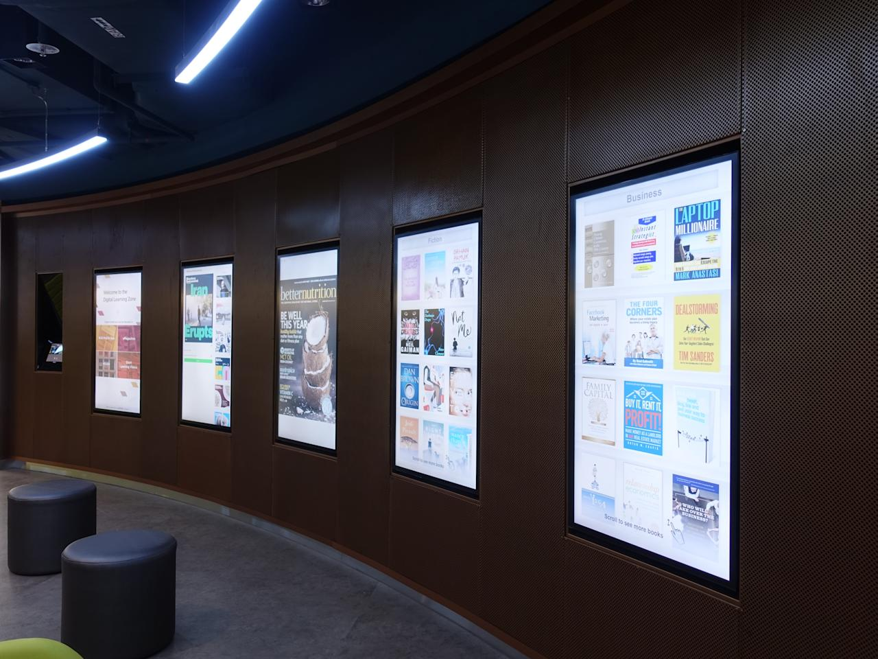 <p>Eye-catching screens for readers to browse through e-magazines and e-books at the digital learning zone. (Photo: Nurul Azliah/Yahoo Lifestyle Singapore) </p>