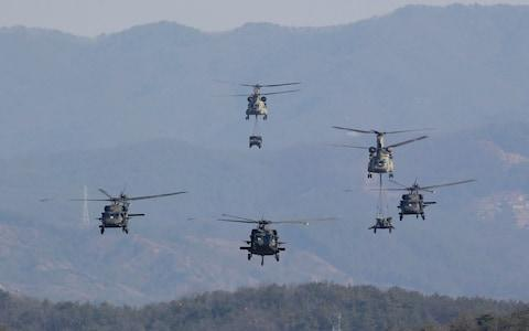 U.S. Army's Blackhawk and Chinook helicopters fly during a combined arms live-fire exercise during the annual joint military exercise Foal Eagle - Credit: AP