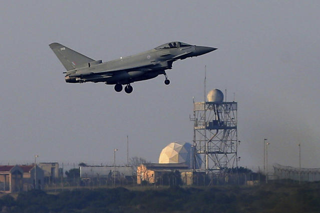 <p>A Typhoon aircraft prepares for landing at the British Royal Air Force base in Akrotiri, near costal city of Limassol in the eastern Mediterranean island of Cyprus, early Saturday, April 14, 2018. (Photo: Petros Karadjias/AP) </p>
