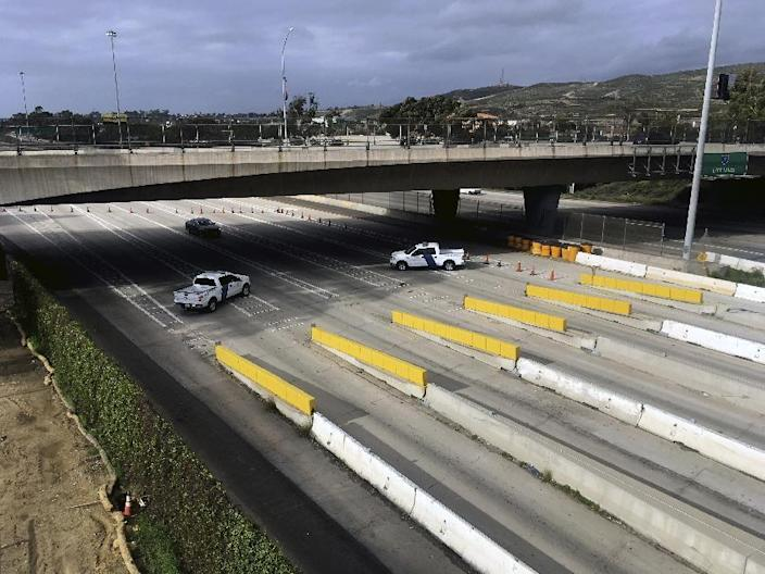 United States Customs and Border Protection officials block access to Tijuana, Mexico, at the San Ysidro Port of Entry with San Diego, Calif., Sunday, Jan. 22, 2017. Protesters took control of vehicle lanes at one of the busiest crossings on the U.S. border Sunday to oppose Mexican gasoline price hikes, waving through motorists into Mexico after Mexican authorities abandoned their posts. (AP Photo/Elliot Spagat)