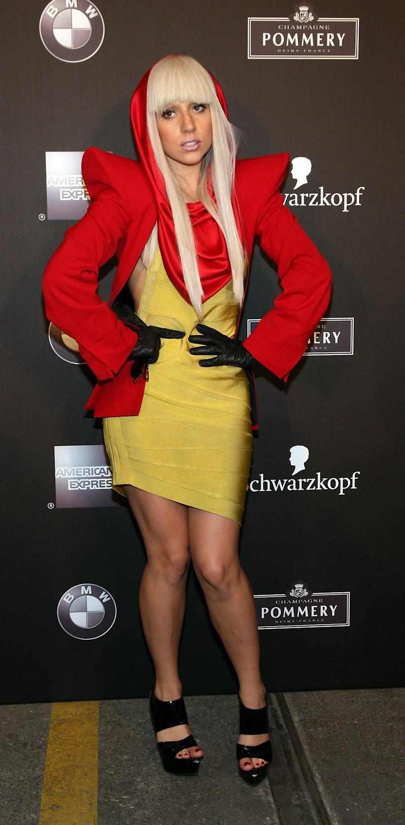 Lady Gaga at a Fashion Week event in 2008, complete with towering shoulder pads and signature snood.