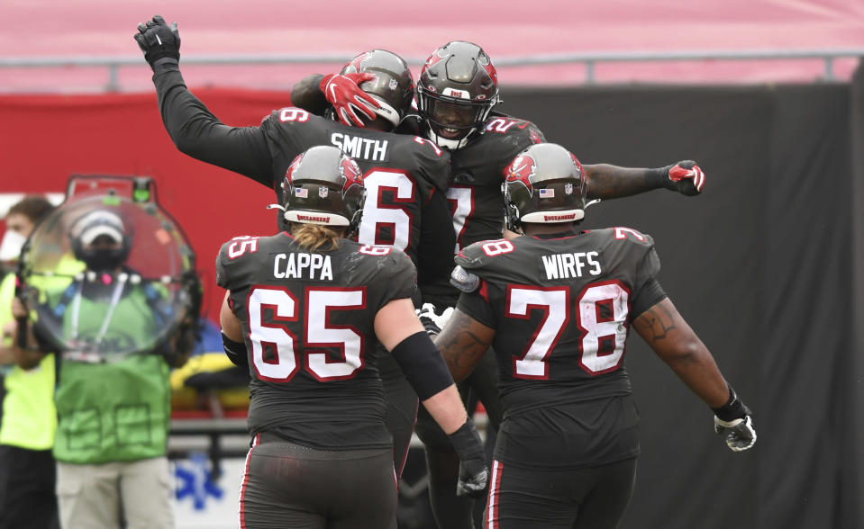 Tampa Bay Buccaneers running back Ronald Jones (27) celebrates after his score against the Atlanta Falcons during the second half of an NFL football game Sunday, Jan. 3, 2021, in Tampa, Fla. (AP Photo/Jason Behnken)