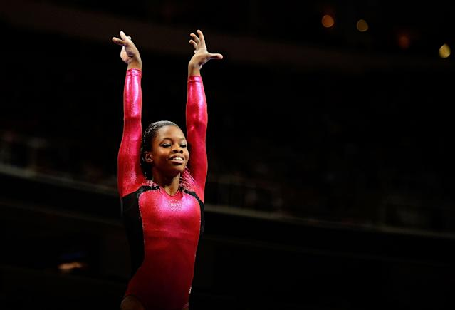 SAN JOSE, CA - JUNE 29: Gabrielle Douglas reacts after competing on the beam during day 2 of the 2012 U.S. Olympic Gymnastics Team Trials at HP Pavilion on June 28, 2012 in San Jose, California. (Photo by Ronald Martinez/Getty Images)