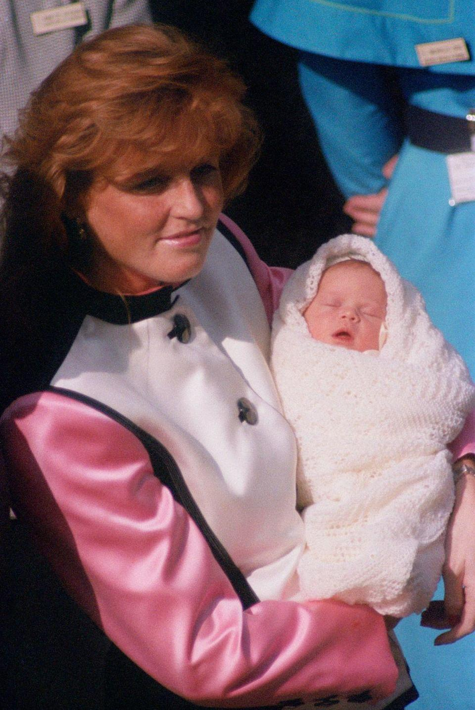 """<p>A newborn Princess Eugenie naps while her mother Sarah, the Duchess of York, cradles her outside the hospital in London. In 2017, Eugenie told <em><a href=""""https://www.harpersbazaar.com/culture/features/a16956/princess-eugenie-of-york-interview/"""" rel=""""nofollow noopener"""" target=""""_blank"""" data-ylk=""""slk:Harper's Bazaar"""" class=""""link rapid-noclick-resp"""">Harper's Bazaar</a></em>, """"What can't I live without? My family. That sounds cheesy, but I really can't. Especially my mum. I wouldn't be able to make tough decisions without her. And my sister. My mum always says that we're the only ones who know exactly what's going on in each other's lives.""""</p>"""