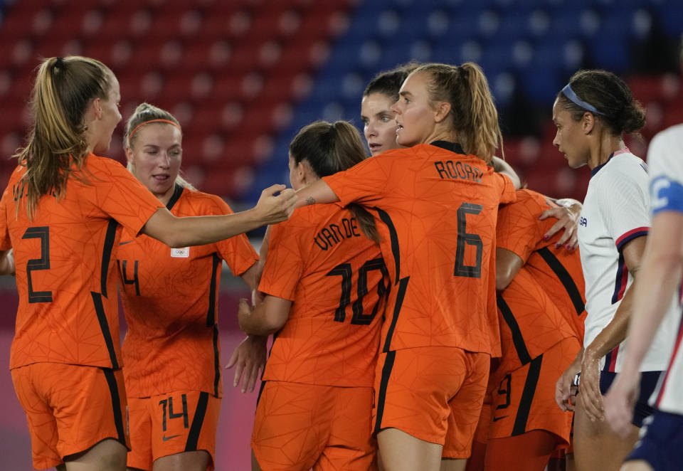 Players of Netherlands celebrate a goal scored by teammate Vivianne Miedema during a women's quarterfinal soccer match against United States at the 2020 Summer Olympics, Friday, July 30, 2021, in Yokohama, Japan. (AP Photo/Kiichiro Sato)