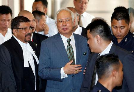 FILE PHOTO: Malaysia's former prime minister Najib Razak walks out of a courtroom in Kuala Lumpur, Malaysia August 8, 2018. REUTERS/Lai Seng Sin/File Photo